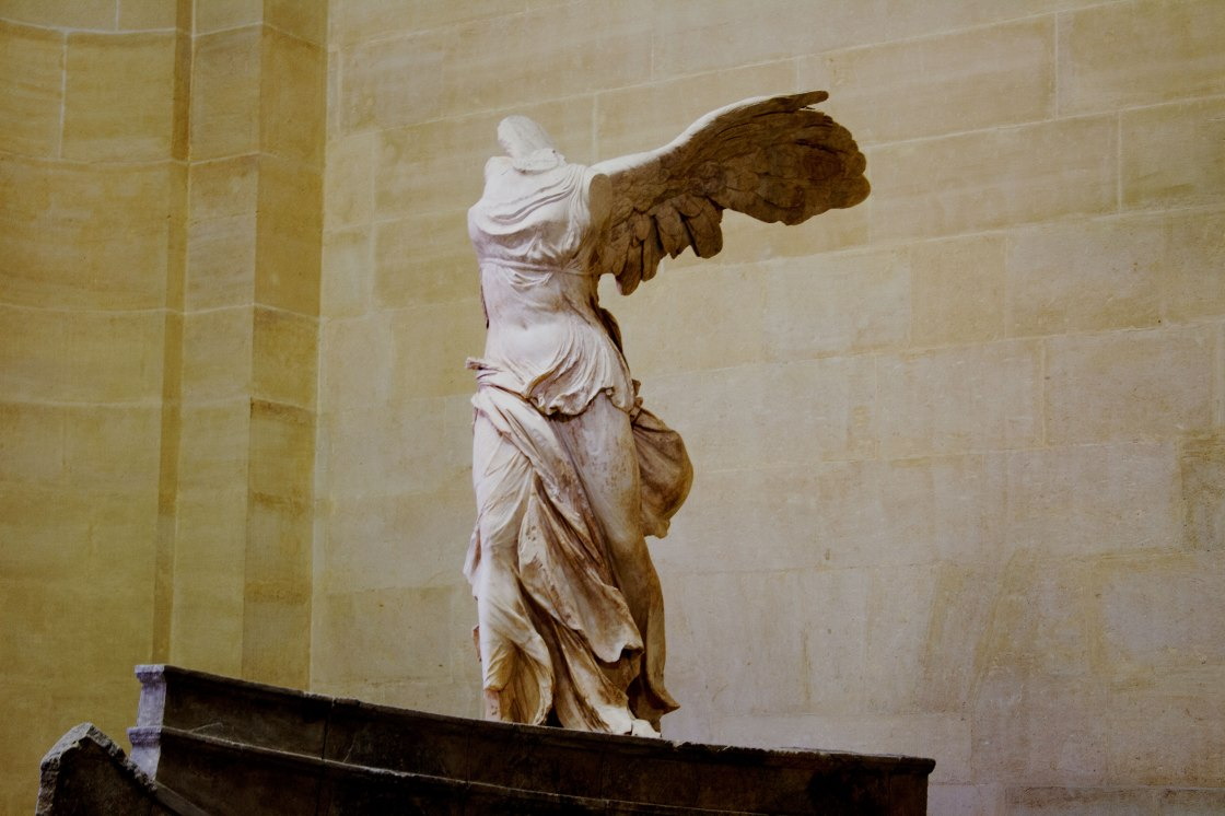 """""""The Winged Victory of Samothrace,"""" housed in The Louvre and sculpted to honor Nike, the Greek goddess of victory 